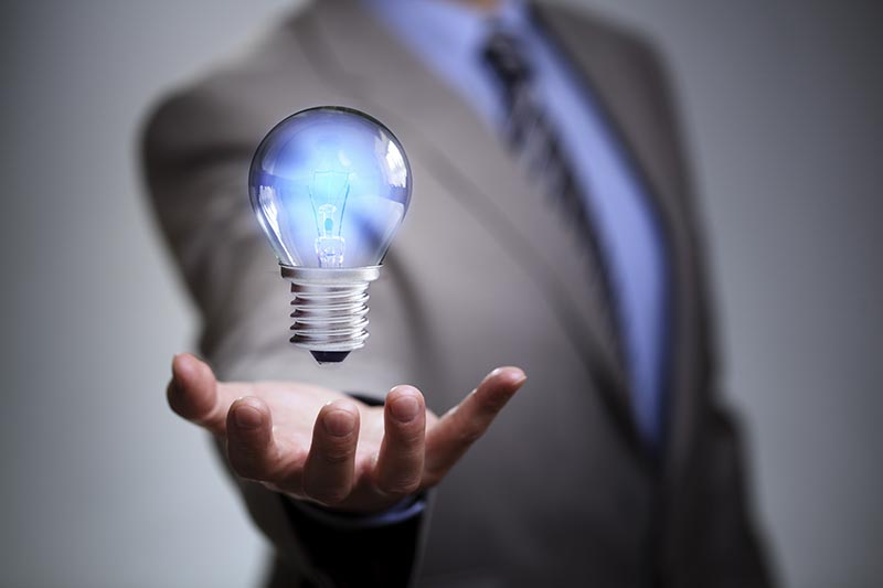 Businessman with illuminated light bulb concept for idea, innova